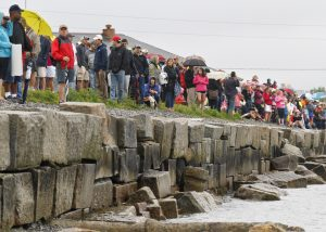 Spectators line the SMCC seawall to watch the swim portion of last year's Tri.