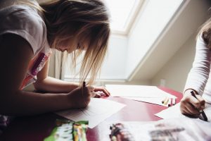 Girls coloring together