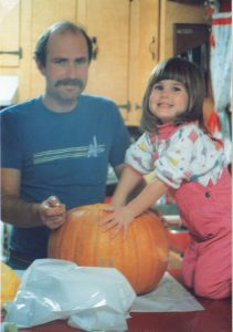 My dad, Brad Bell, and I prepare to carve a pumpkin in our family kitchen. I was all smiles until I realized that the pumpkin didn't have pumpkin pie filling inside.