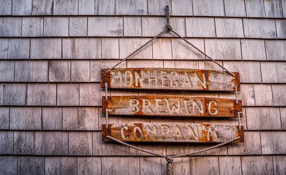 A wooden sign greets customers to the brewery.